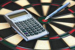 Pen and Calculator over Darts Board Stock Images