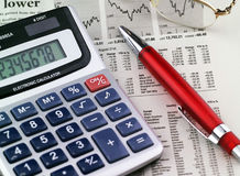 Pen and calculator on paper Royalty Free Stock Images