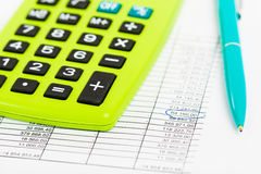 Pen and Calculator on a paper with graph Royalty Free Stock Photography