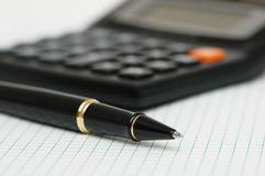 Pen and calculator  with shallow depth of field Stock Images