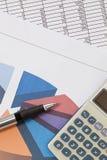 Pen and Calculator with Spreadsheet Stock Photos