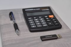 Pen, calculator and usb stick in the office royalty free stock photo