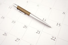 Pen on calendar. Ballpoint pen on calendar page Royalty Free Stock Photography