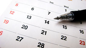 Pen and calendar. Black pen on an empty calendar stock images
