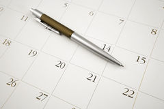 Pen on calendar Stock Photo