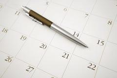 Pen on calendar. Ballpoint pen on calendar page Stock Photo