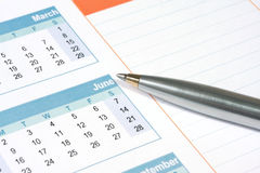 Pen on Calendar Royalty Free Stock Images
