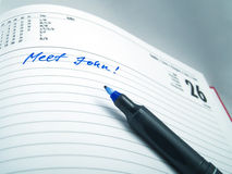 Pen on a calendar Royalty Free Stock Images