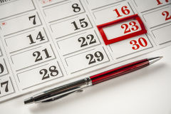 Pen And a Calendar. Pen And Important Date On Calendar On White Background Stock Photos