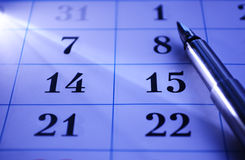Pen on a calendar. Pen lying on a calendar showing weekly dates covering two specific days left blank for your schedule or meetings Royalty Free Stock Photo