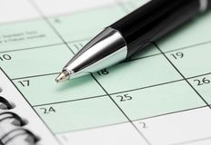 Pen  on Calendar Page Stock Image