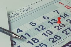 Pen on calendar page, business concept and time Stock Images