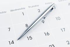 Pen on calendar. Page closeup Stock Images