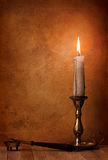 Pen and candle. In retro style stock photography