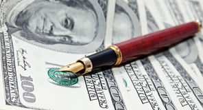 Pen and cash Royalty Free Stock Photography