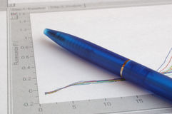 Pen and chart. Blue pen and scientific graph Stock Photos