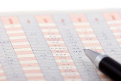 Pen on a chart. Table, pen Stock Photos