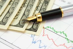 Pen, chart and money. Fountain pen and money on the exchange chart Royalty Free Stock Photo