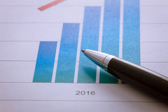 Pen on  chart in 2016 paper. Stock Photo