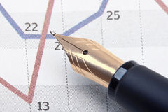 Pen and charts Royalty Free Stock Photography