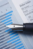Pen and charts Stock Images