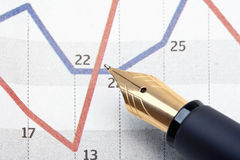 Pen and charts Stock Photos