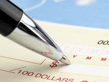 Pen on the Check Royalty Free Stock Photography