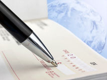 Pen on the Check Stock Photography