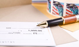 Pen and check. Pen United State stamps and check Royalty Free Stock Image