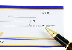 Ballpoint Pen and Blank Check. Ballpoint pen and secure blank check, isolated stock photo