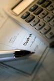 Pen and check Royalty Free Stock Photos