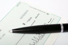Pen on check Royalty Free Stock Photos