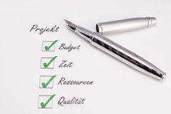 Pen with check marks. Fountain pen with green check marks Royalty Free Stock Photography