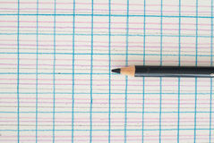 Pen on checkered background. Black pen on a background of different colors Stock Images