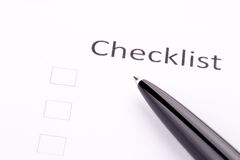 Pen on checklist Royalty Free Stock Images