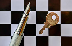 Pen and chessboard Stock Image