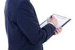 Pen and clipboard in young businessman's hands isolated on white stock photography