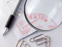 Pen, clips & stamped envelop close-up with the mag Royalty Free Stock Photography