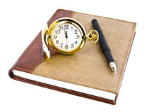 Pen, clock and notebook Stock Photography