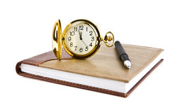 Pen, clock and notebook Royalty Free Stock Photography