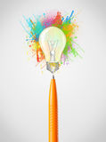 Pen close-up with colored paint splashes and lightbulb. Concept Stock Image
