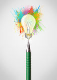 Pen close-up with colored paint splashes and lightbulb. Concept Stock Photos