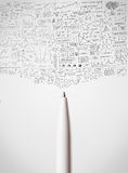 Pen close-up with sketchy diagrams. White Pen close-up with sketchy diagrams Royalty Free Stock Image