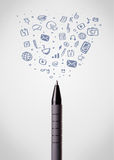 Pen close-up with social media icons Royalty Free Stock Photography