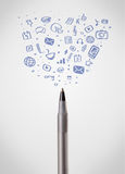 Pen close-up with social media icons Royalty Free Stock Photo