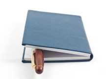 Pen in closed blue notepad Stock Photos