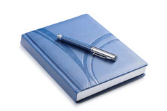 Pen and a closed notebook Stock Photography