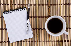 Pen and Coffee Cup. Royalty Free Stock Photos