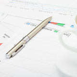 Pen and coffee cup financial charts - close up shot Stock Image