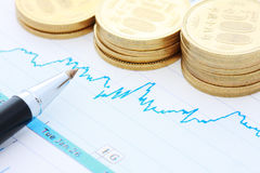 Pen coins and chart Stock Photography